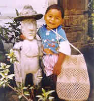 Mayan child and Mayan statue